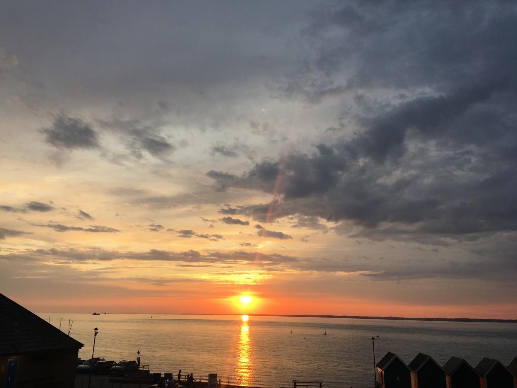 isle of wight; beach hut; gurnard; sea swimming; orange hat ladies; swimming women; wild swimming
