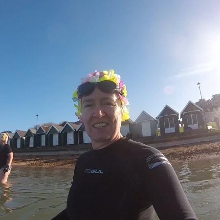 orange hat ladies, sea swimming, wild swimming, women swimming, swimming kit