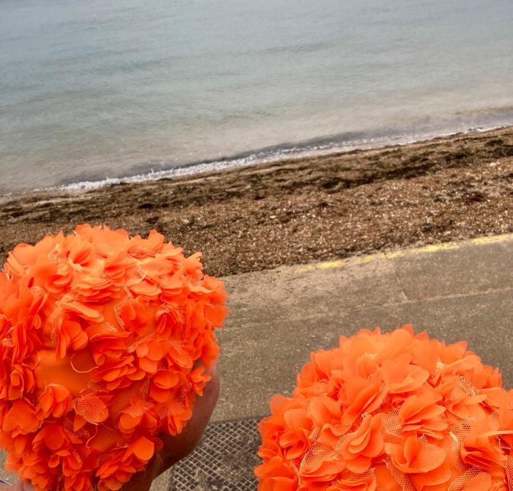orange hat ladies, swimming women, sea swimming